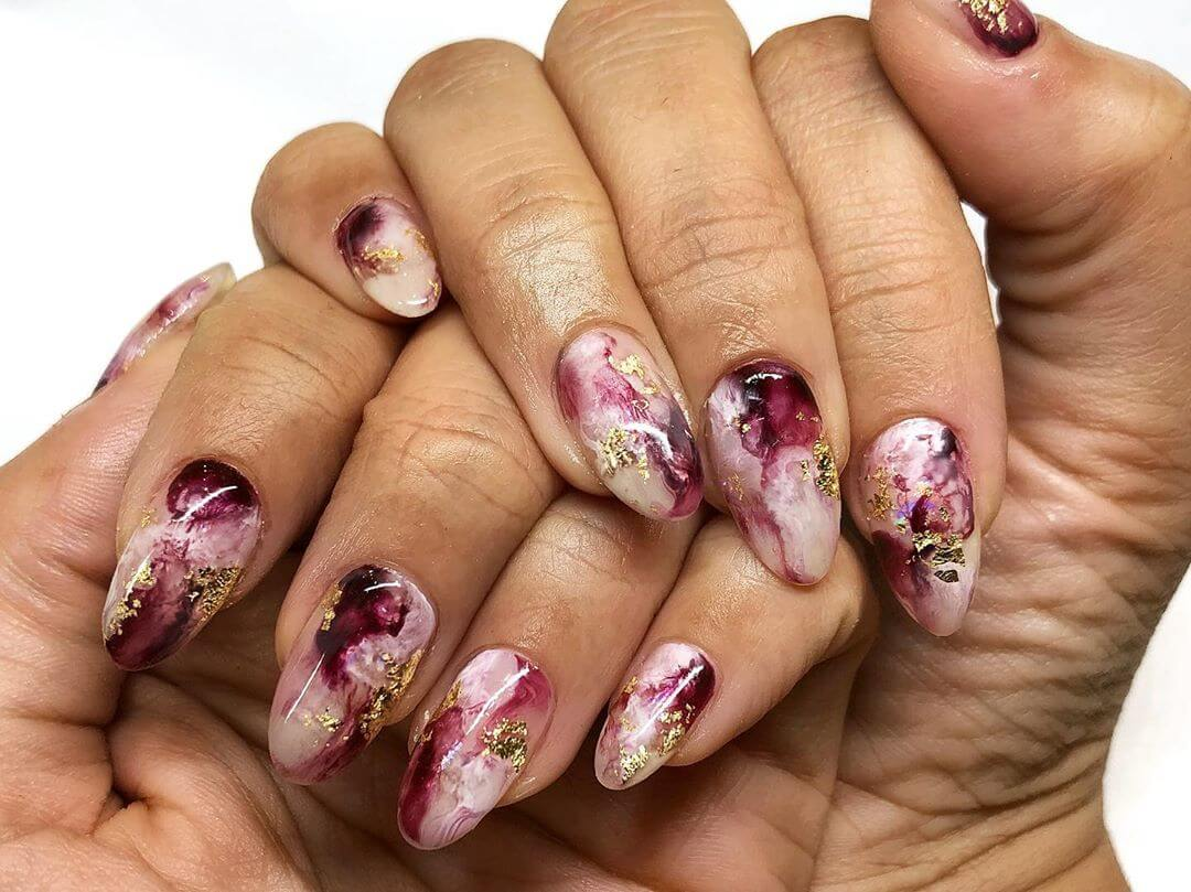 Gold foil on natural nails Marble Nail Art Designs