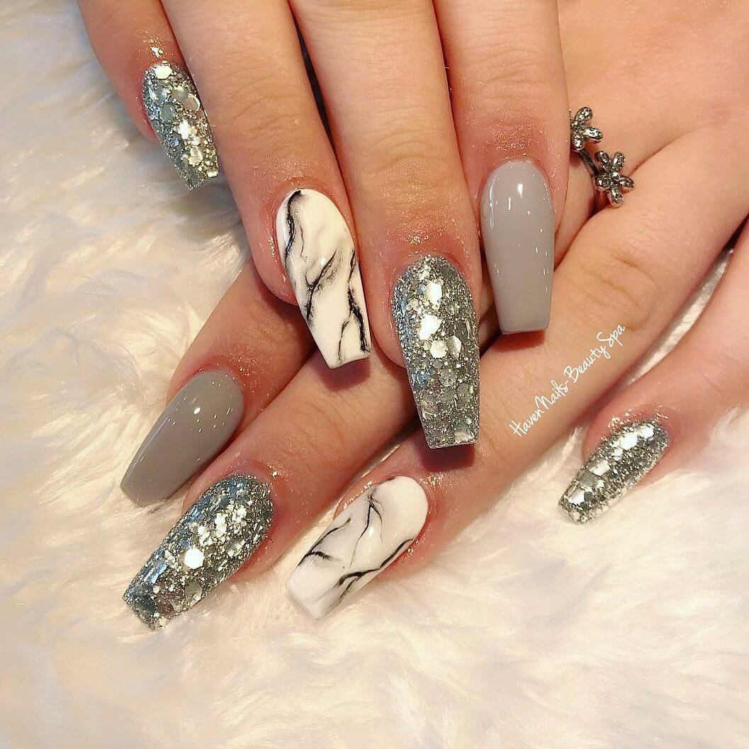 Marbles with silver embellishments.Marble Nail Art Designs