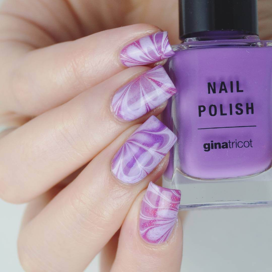 Purple nail art! Marble Nail Art Designs