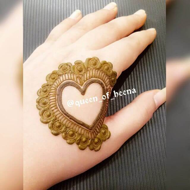 small heart mehndi design on back hand for Valentine Day Special