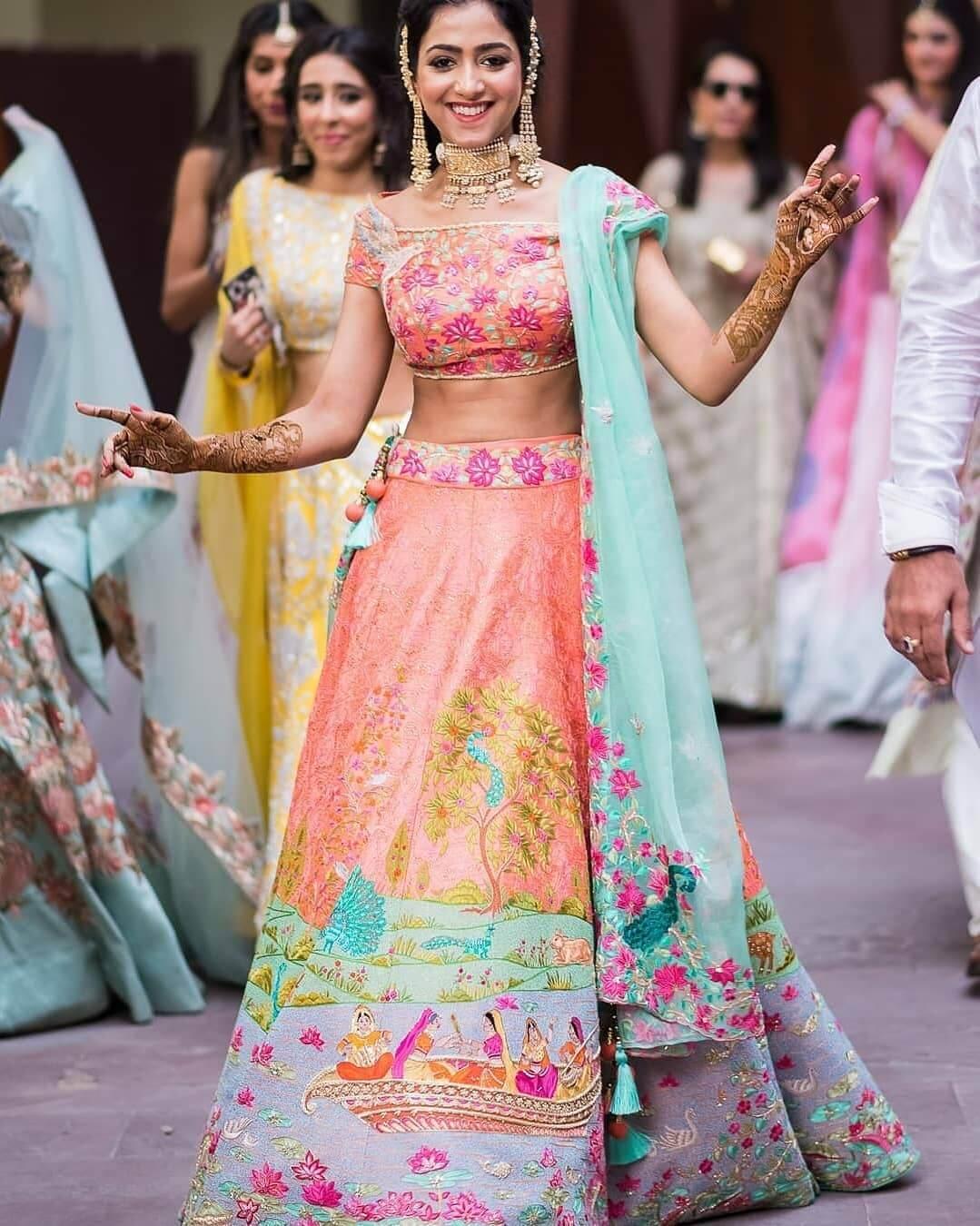 dancing pose of bridal in mehndi function
