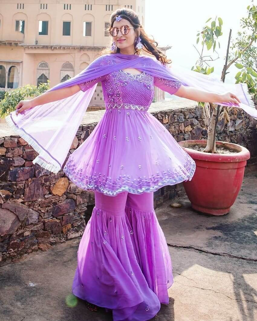 purple sharara suit with floral jewellery or beautiful Kalire