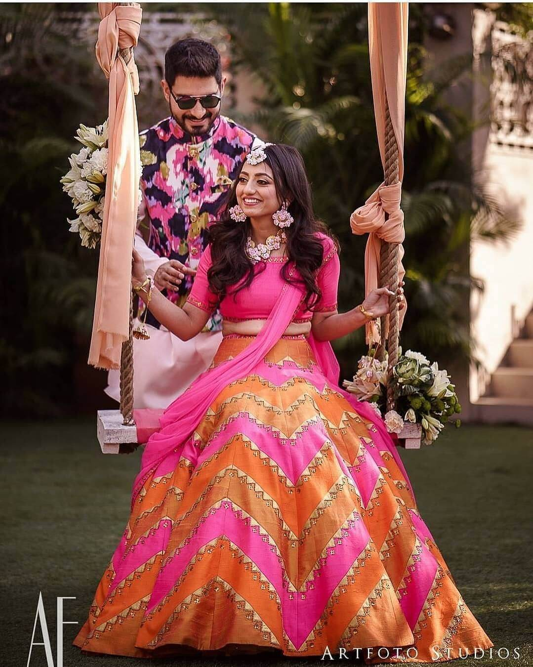 orange and hot pink lehenga for her mehndi ceremony