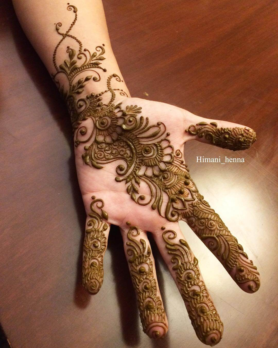 Motifs And Zig-Zags mehendi designs for hands