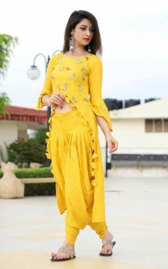 Short height ladies and girls looking party ready in Indian yellow center slit kurti patiala