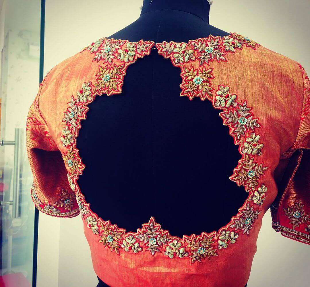 .Lovely Orange Blouse For South Indian Brides