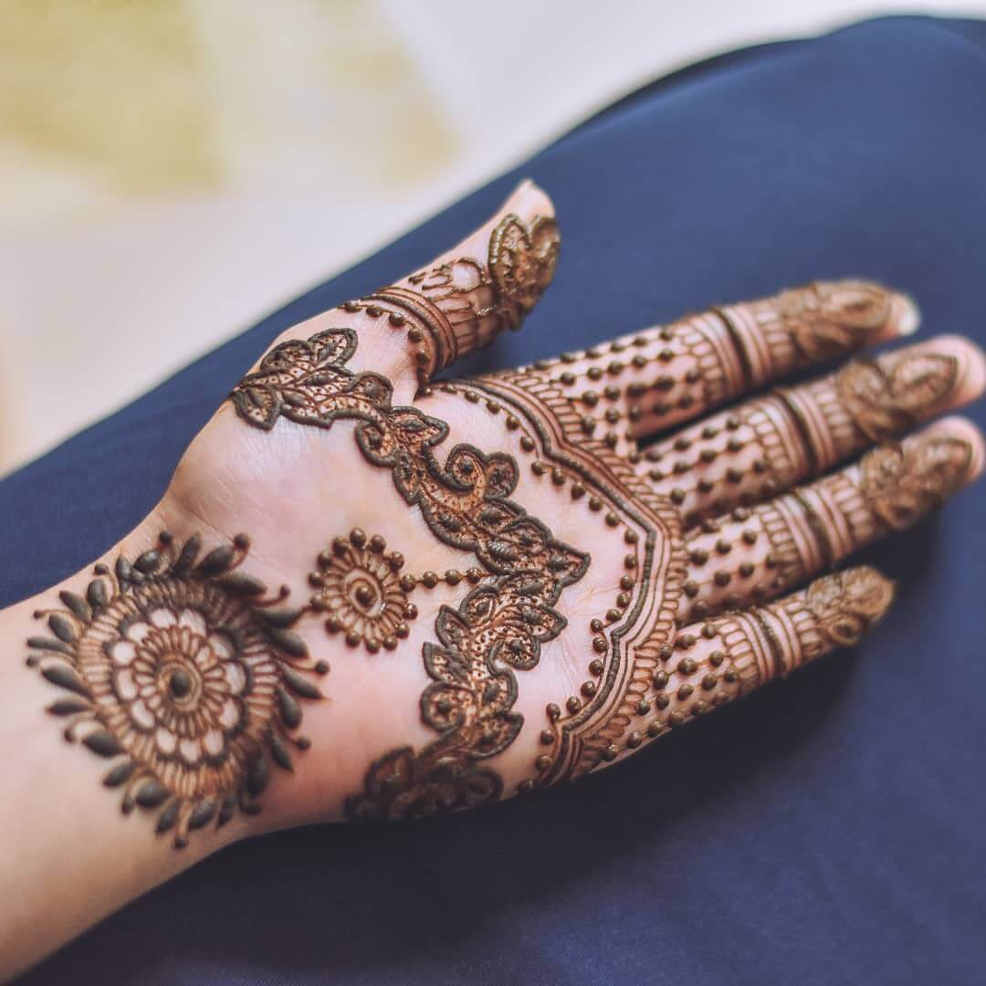 Elaborate strip design for eye-filling bridesmaids Half Hand Mehndi Design