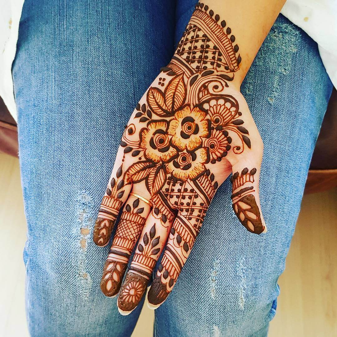 Comely floral motifs for homely brides and bridesmaids Half Hand Mehndi Design
