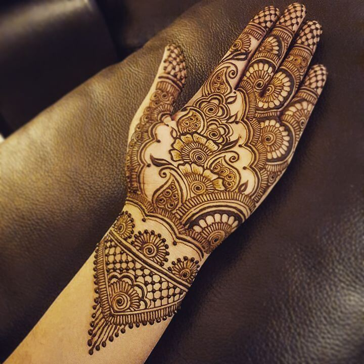Intricate wrist pattern with floral patterns for classic brides Half Hand Mehndi Design