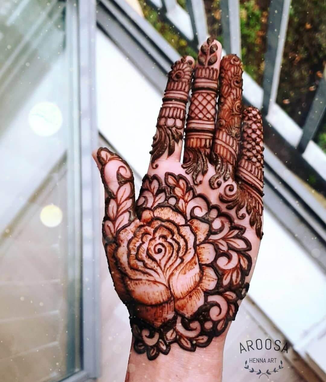 Rose with bold leaves design for radiant brides Half Hand Mehndi Design