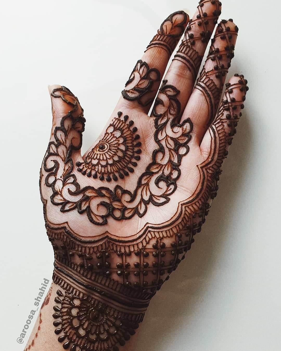 Intricate strip leaves and semi mandalas for simplistic bridemaids Half Hand Mehndi Design