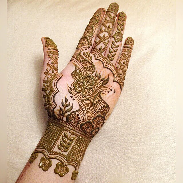Modern flower and paisley design for mesmerizing brides Half Hand Mehndi Design
