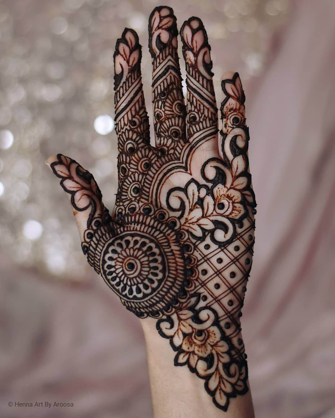 Devious mandalas and floral pattern for grand bridesmaids Half Hand Mehndi Design