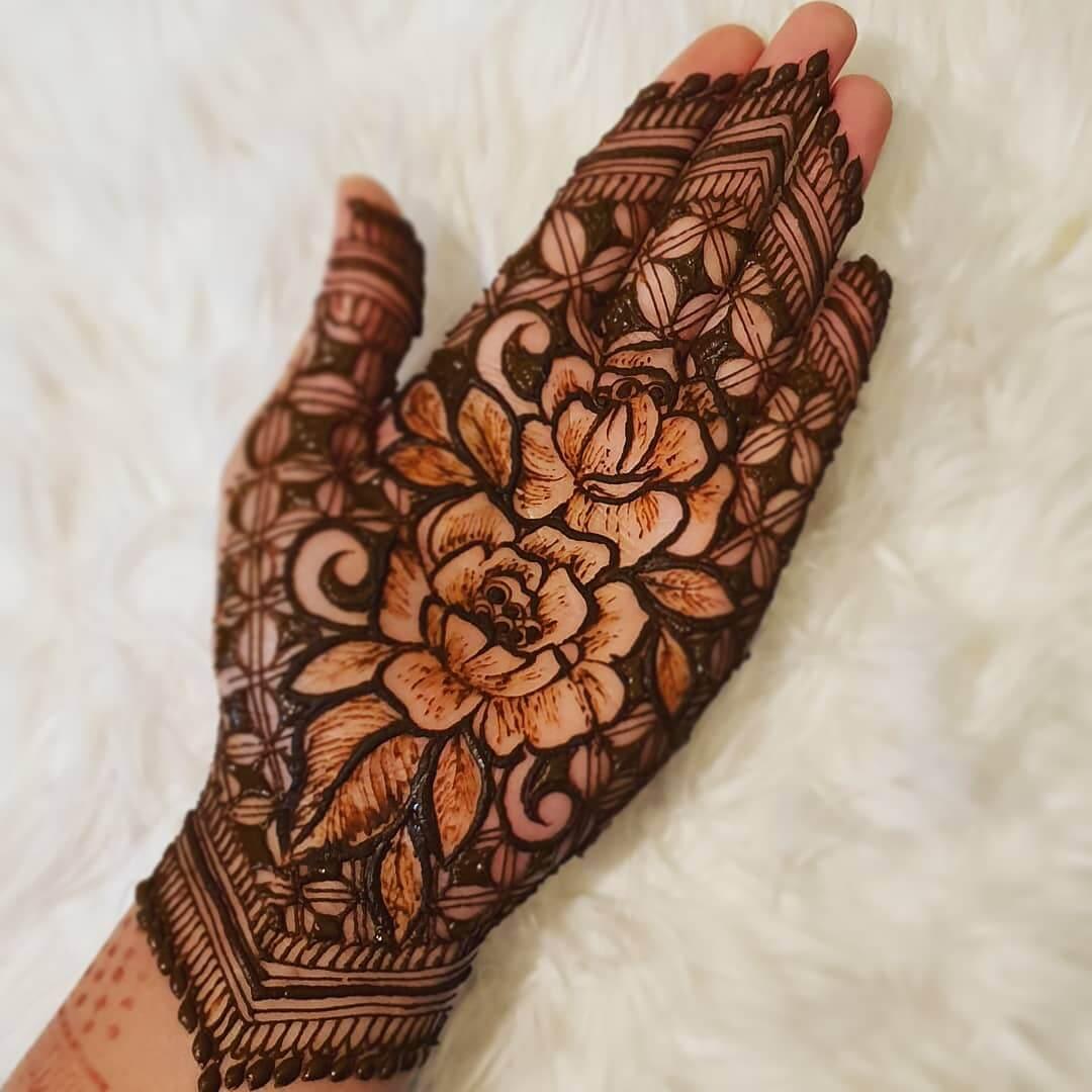Intricate floral and leaves design for genteel brides Half Hand Mehndi Design