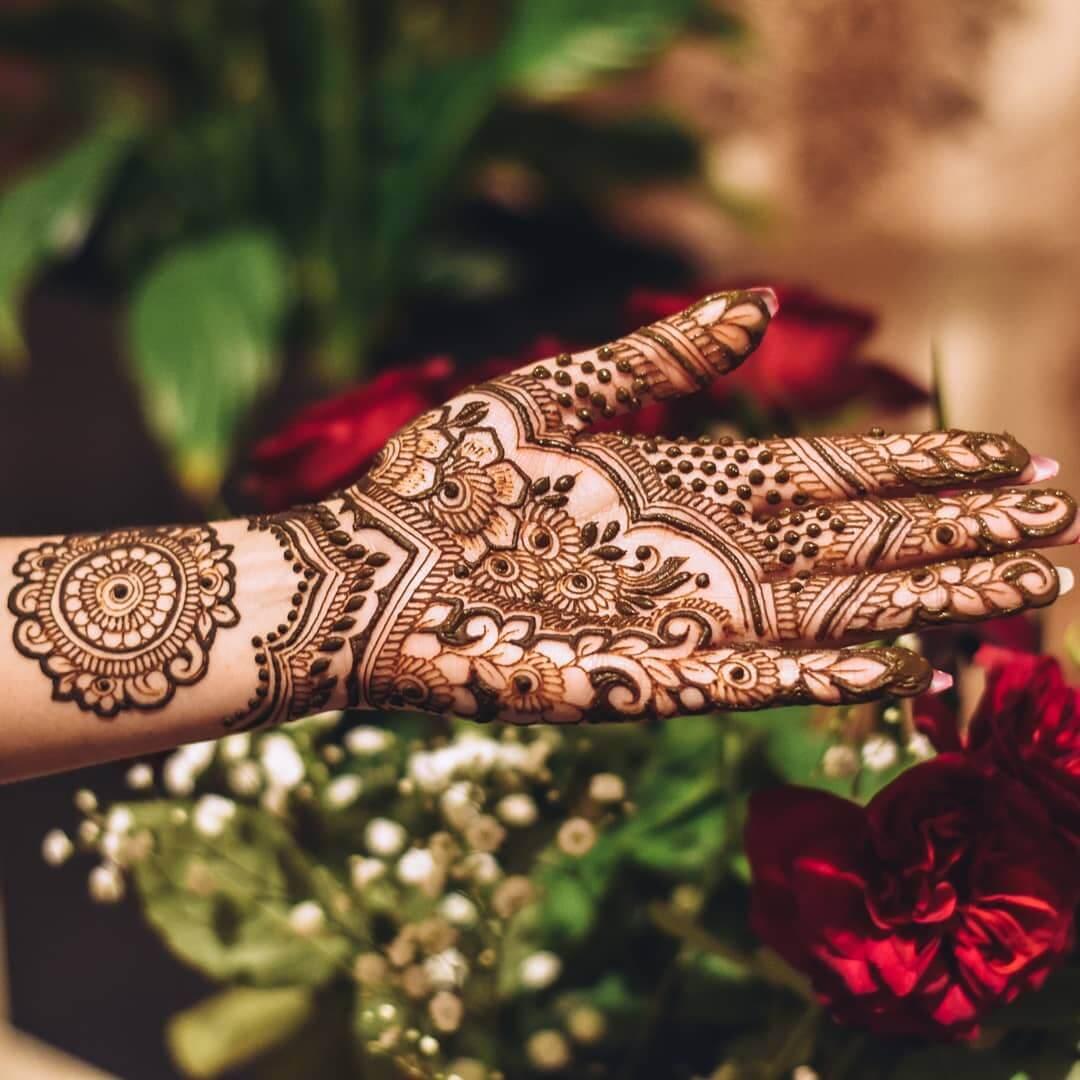 Grand floral motifs for gorgeous brides Half Hand Mehndi Design