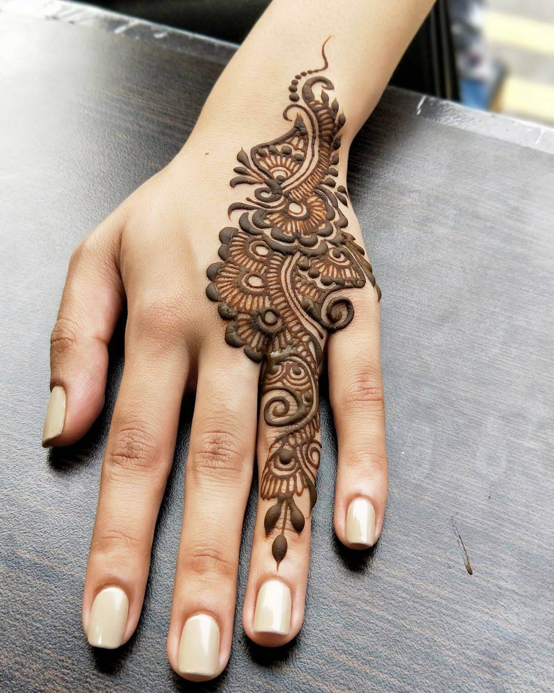 One Finger Floral And Paisley Mehndi Design