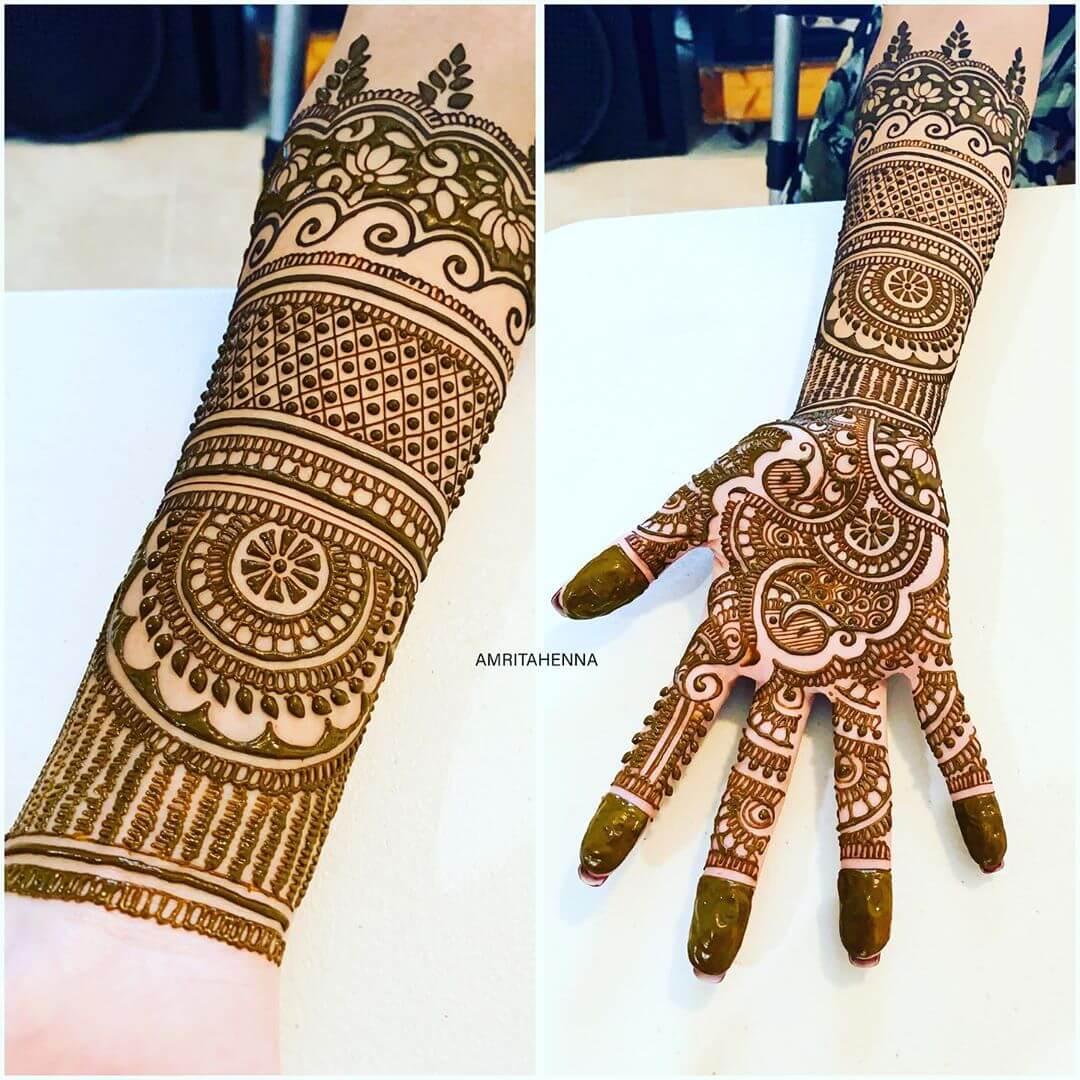 Classy Peacock Mehndi Design For Full Hand