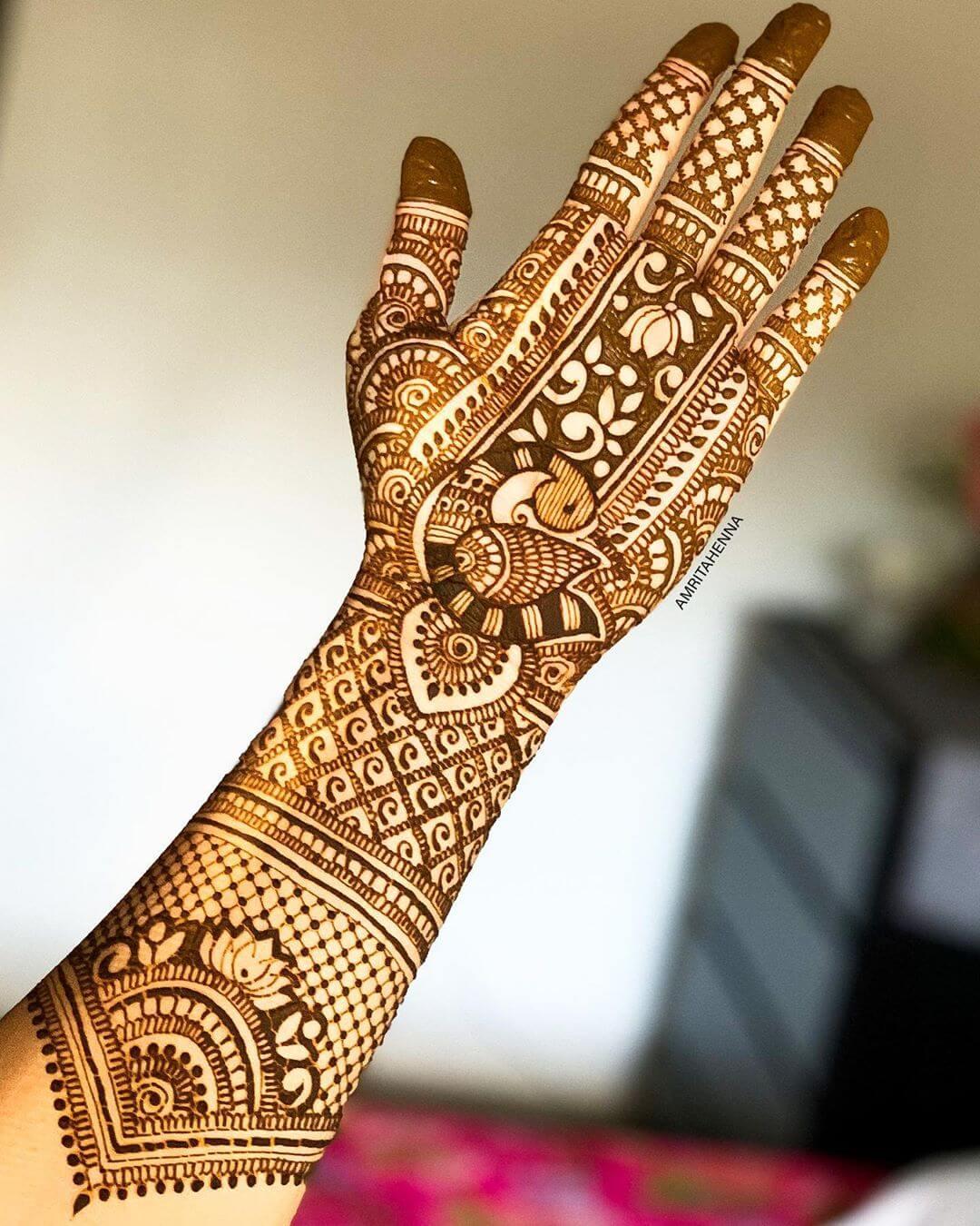 Delicate Peacock Mehndi Design For Full Hand