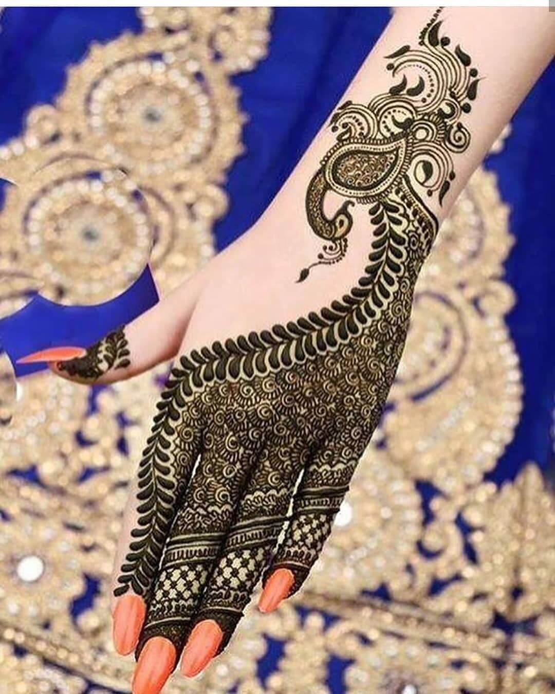 Bewitching Peacock Mehndi Design For Back Of The Palm