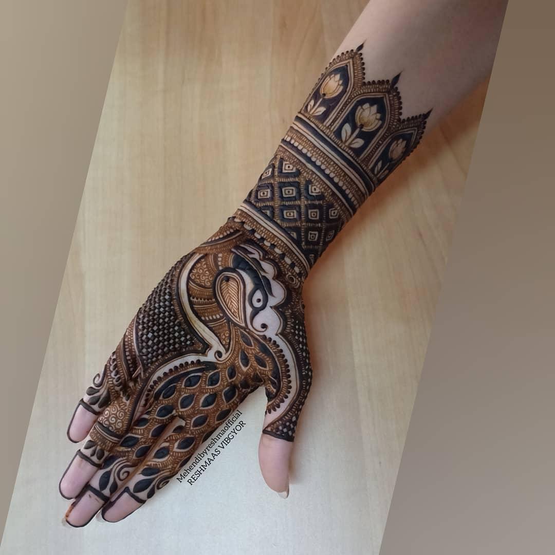 Gracious Peacock Mehndi Design For Palm