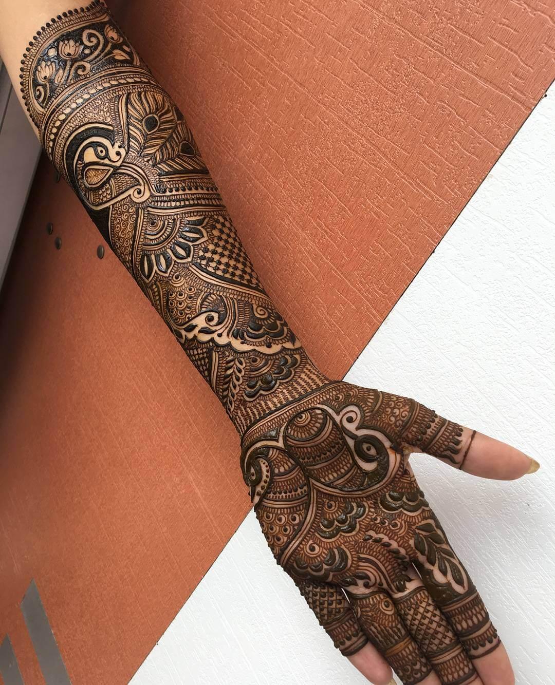 Tantalizing Peacock Mehndi Design For Full Hand