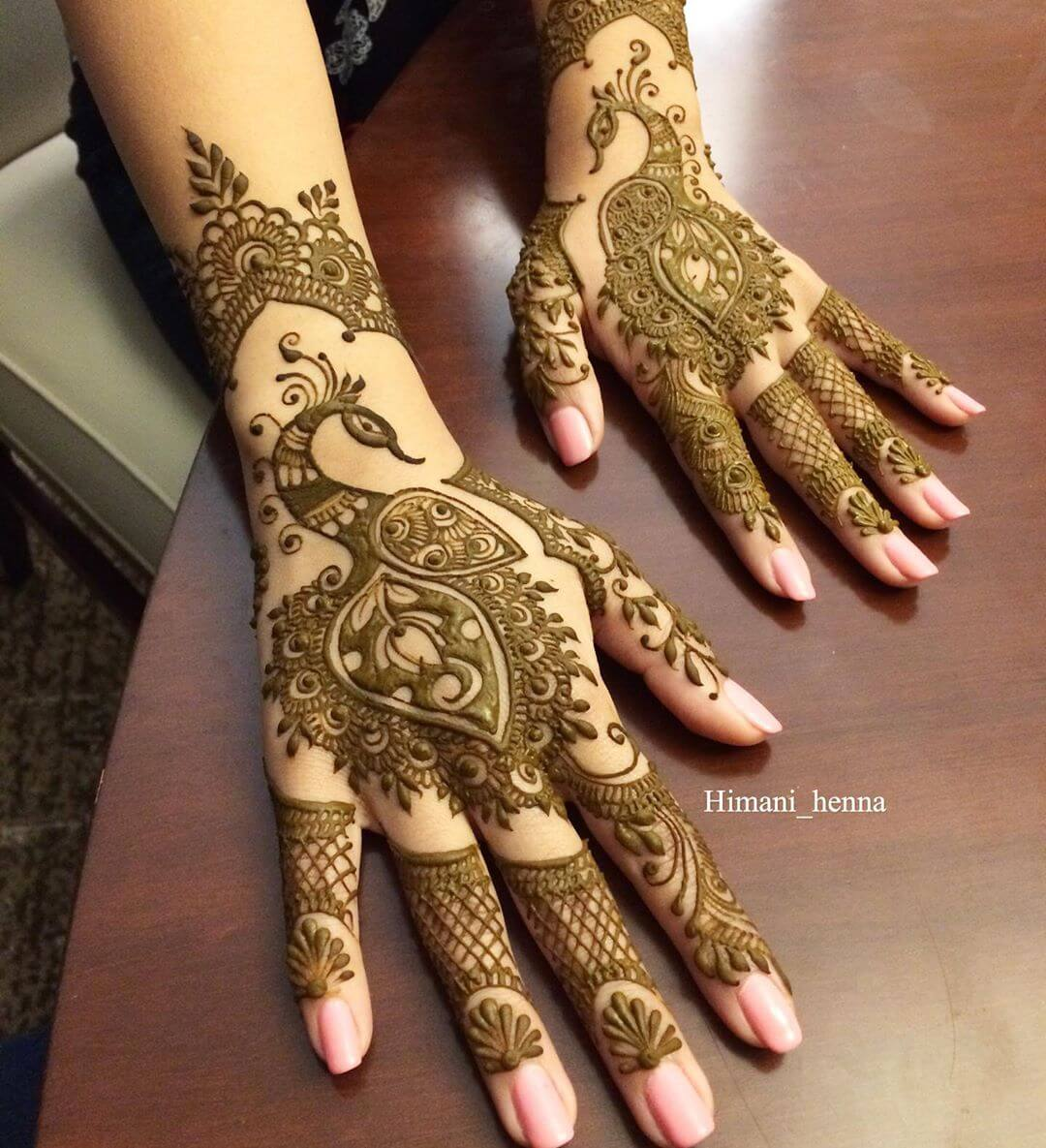Exquisite Peacock Mehndi Design For Back Of The Palm