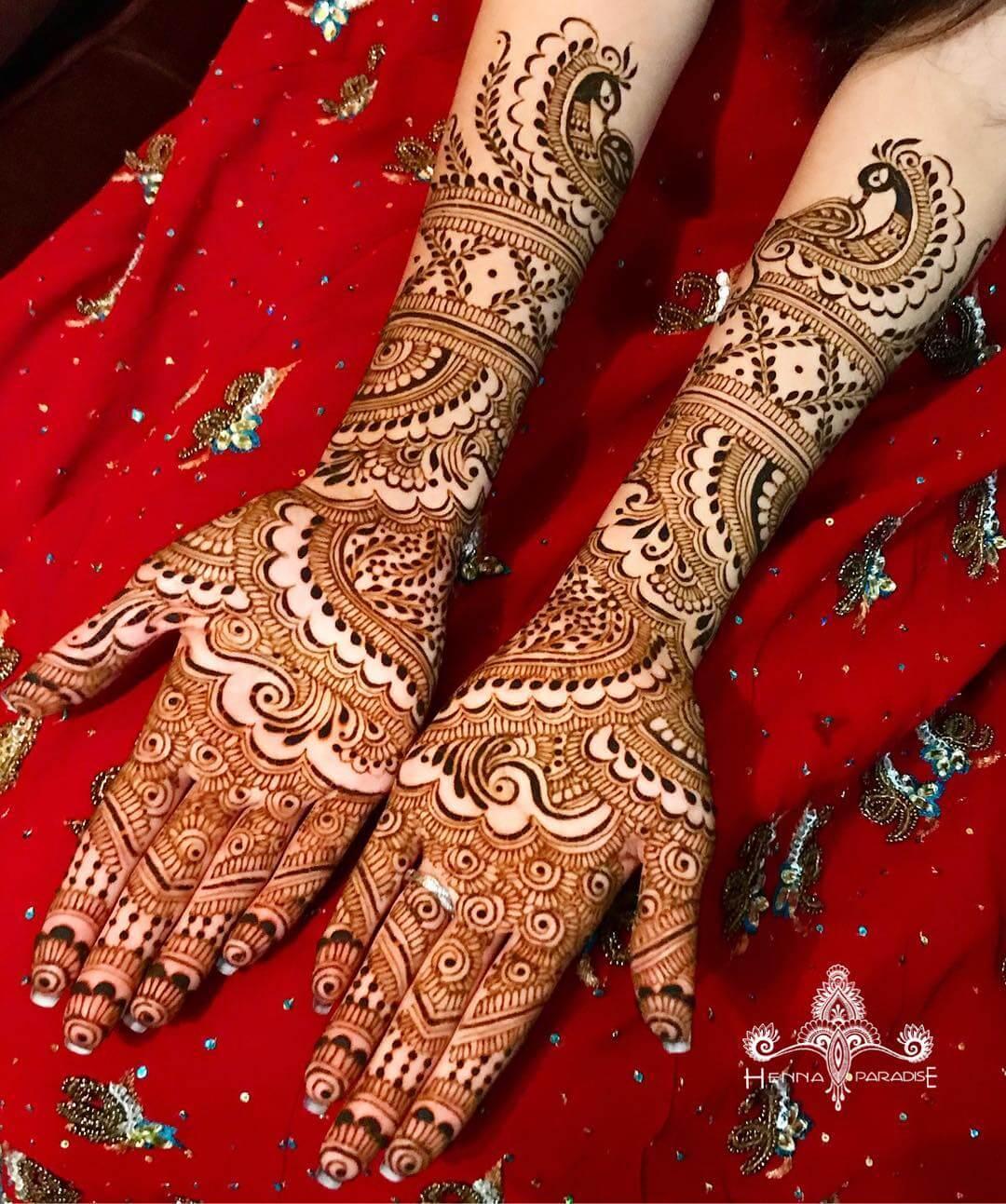 Enchanting Peacock Mehndi Design For Full Hands