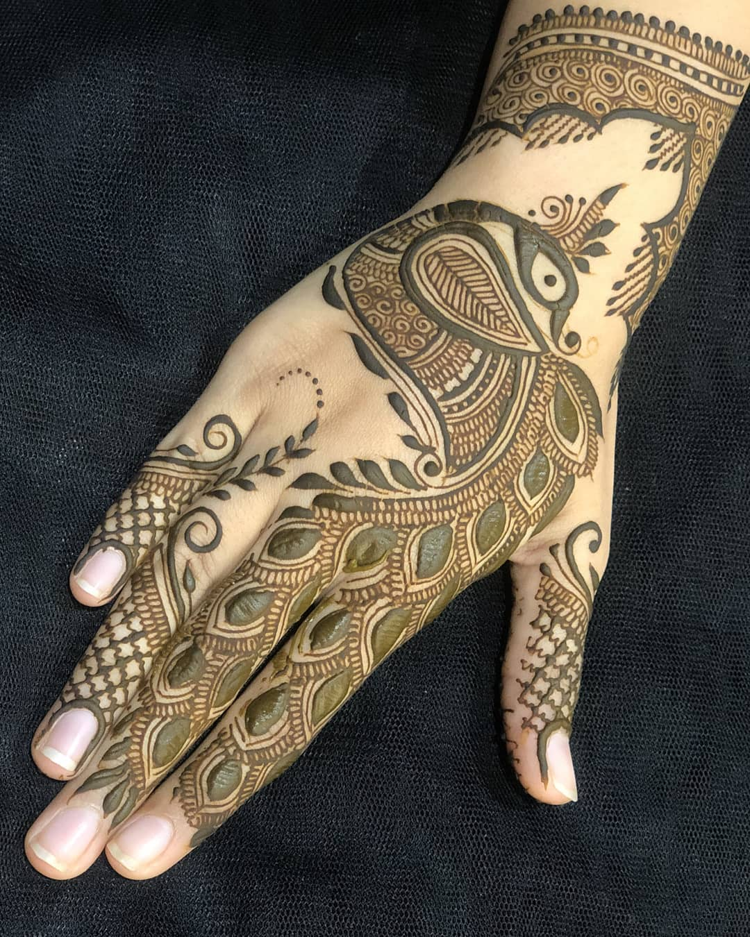Pleasing Peacock Mehndi Design For Back Of The Palm