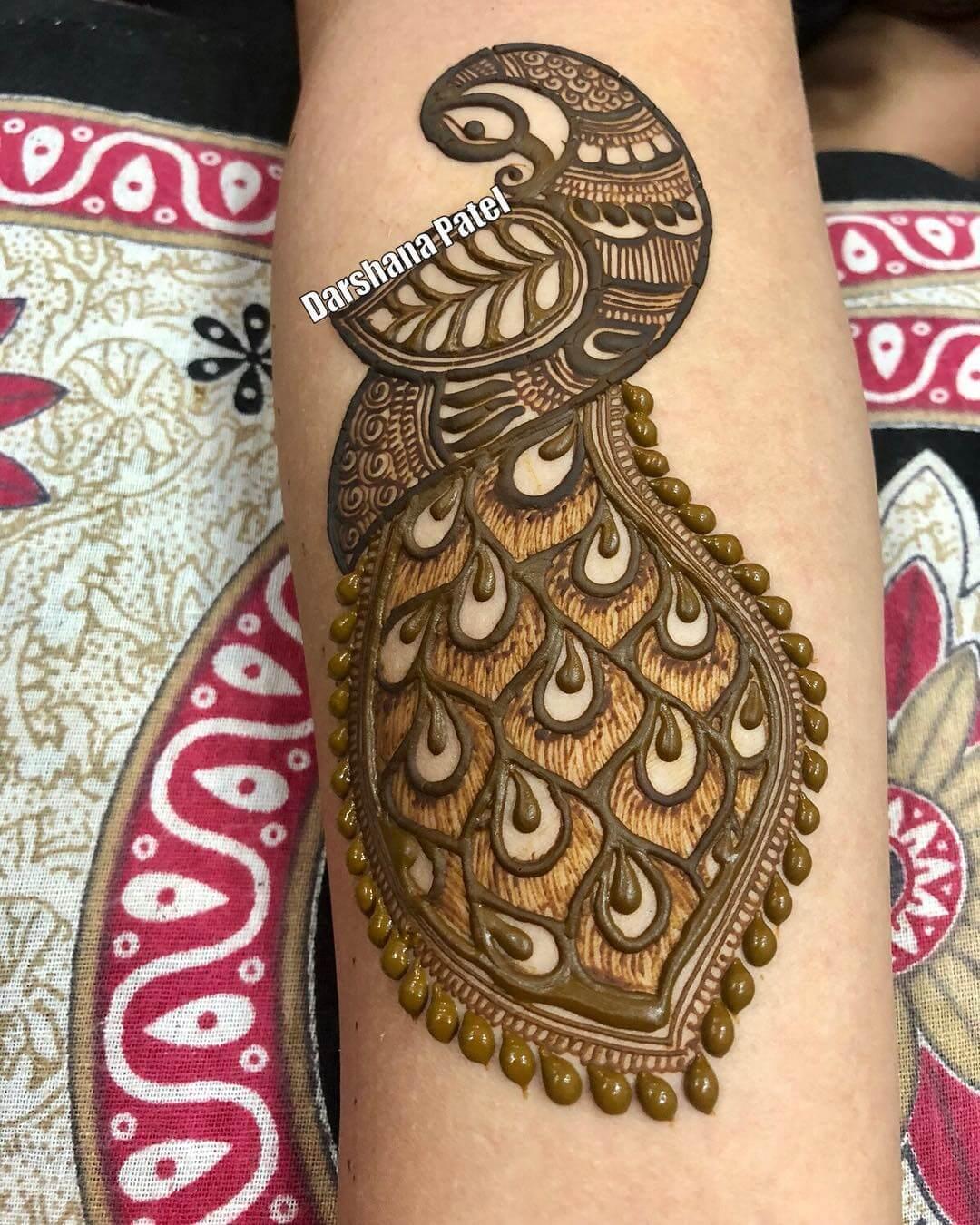 Unique Peacock Mehndi Design For Arm