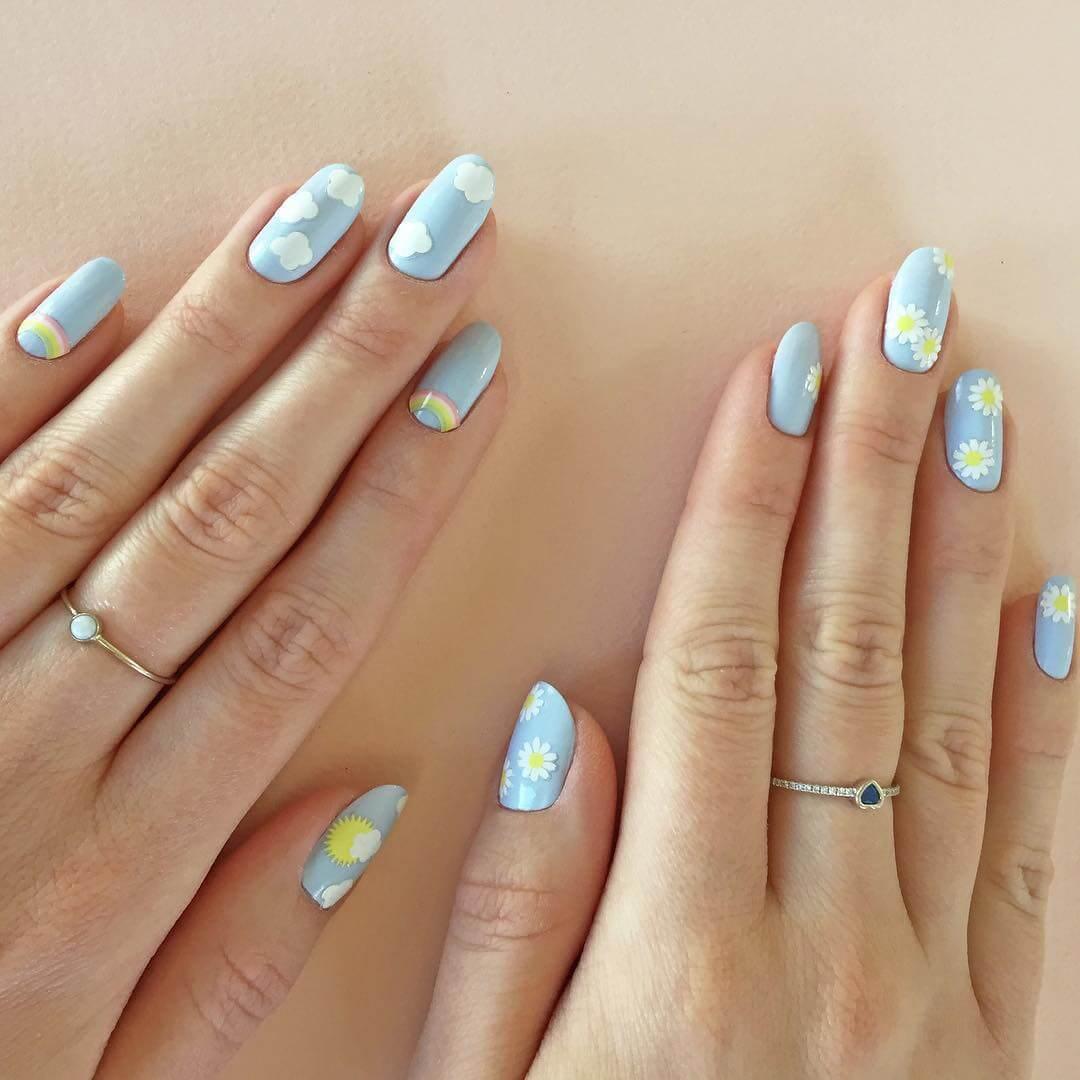 Cloudy floral Spring nail designs for medium nails