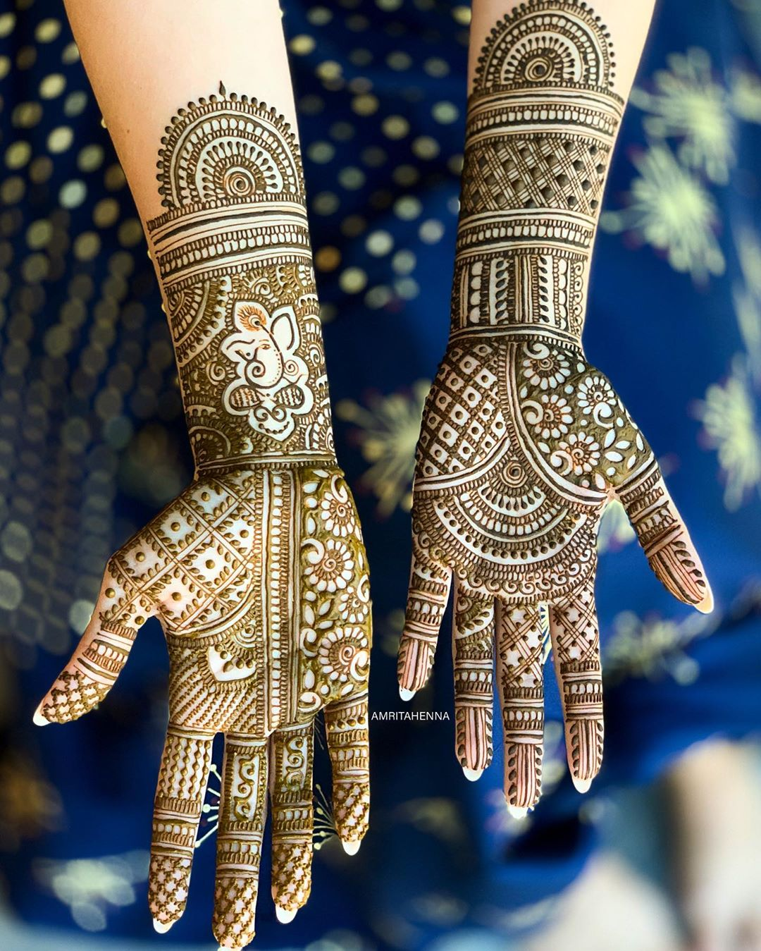 Gorgeous Lord Ganesh Marwari style mehendi for goodly brides