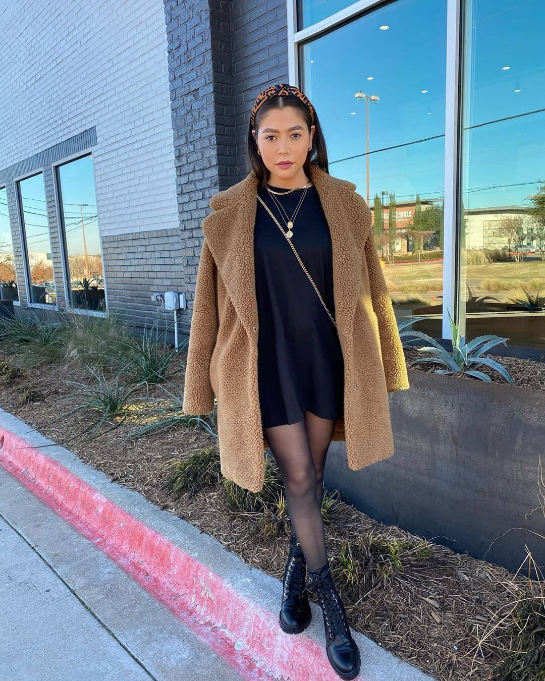 Pairing the little black tshirt dress with a fur coat