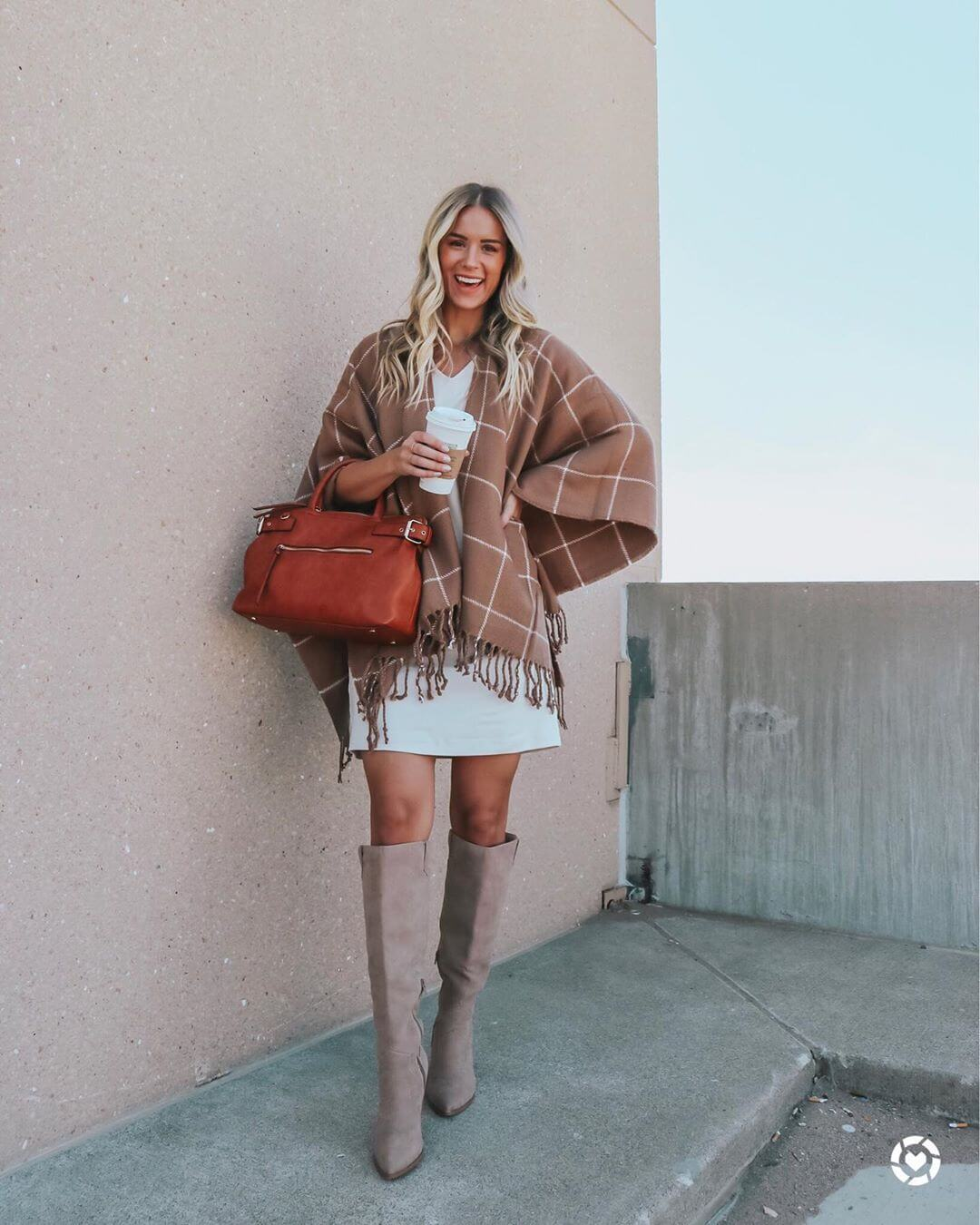 Add a poncho to the tshirt dress for the best fall look