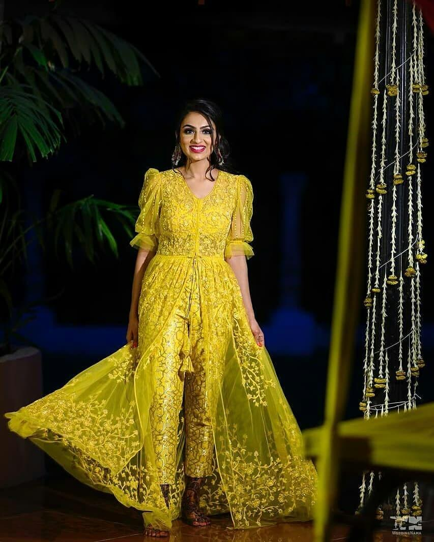 Net yellowish bridal jumpsuit outfit for Haldi-Mehndi Ceremony