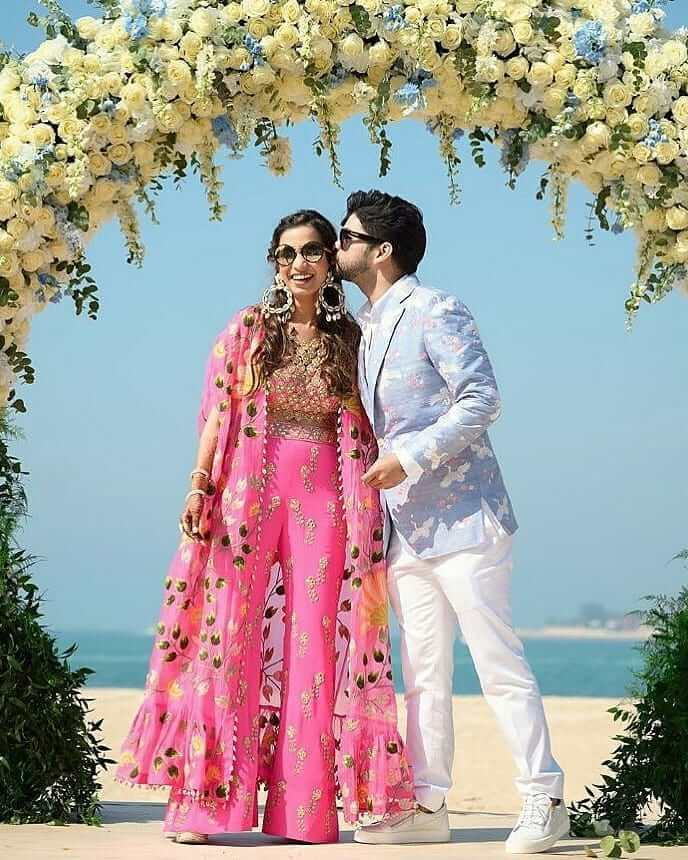 Pink shrug bridal jumpsuit outfit for Haldi-Mehndi Ceremony