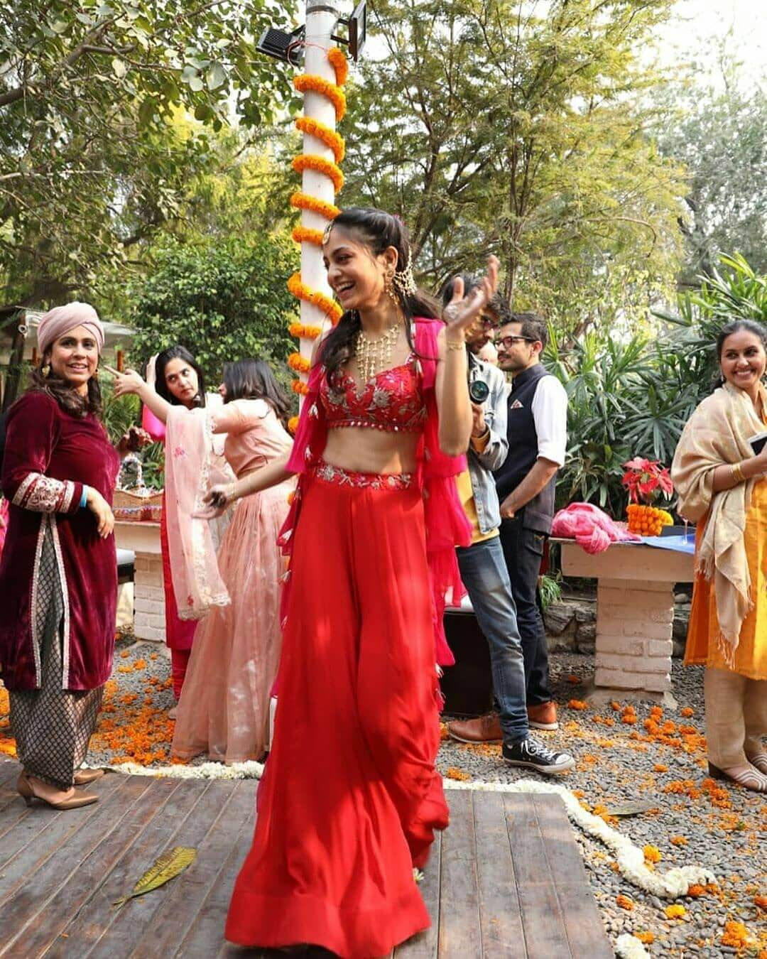 Red bridal jumpsuit outfit for Haldi-Mehndi Ceremony
