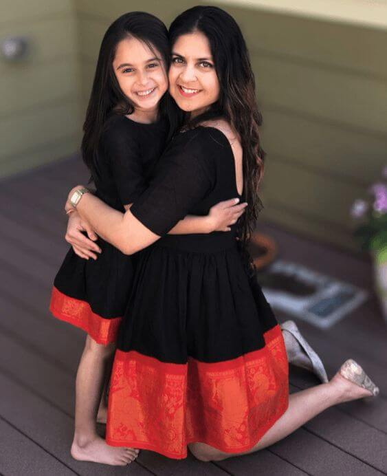 This mother and daughter duo look too pretty in black.