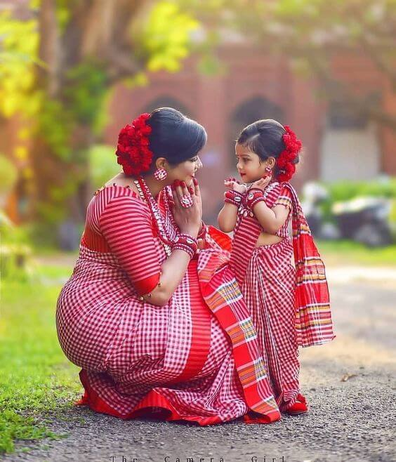 A mother is a daughter's treasure. red saree