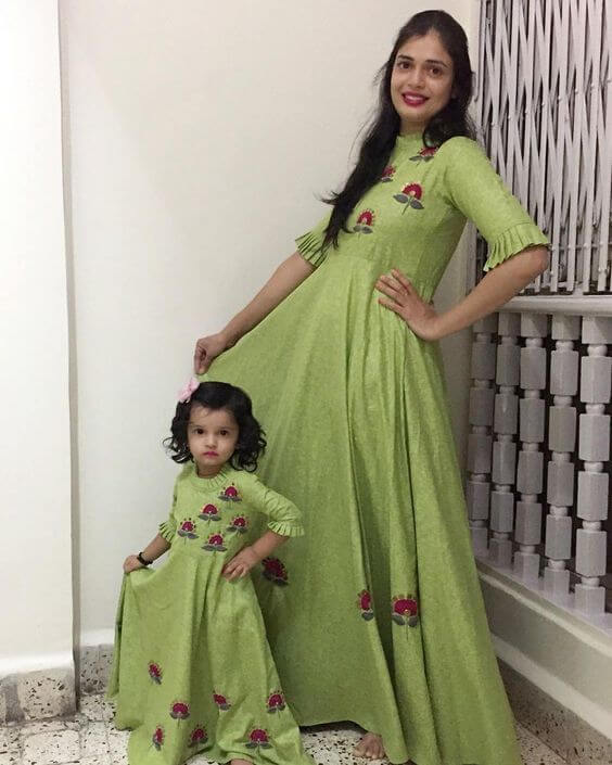simple high neck green gown with flower motifs