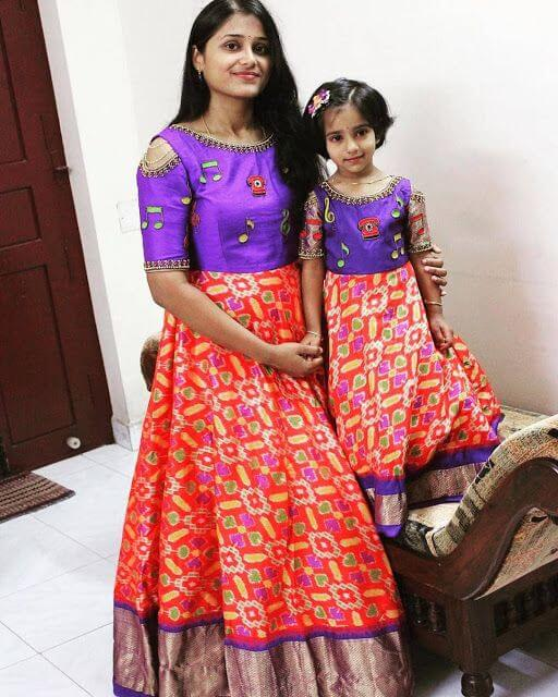Once a mother was also a daughter. violet blouse and red skirt