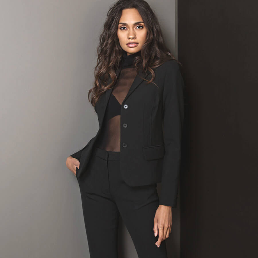 Sheer top with a bra and a blazer
