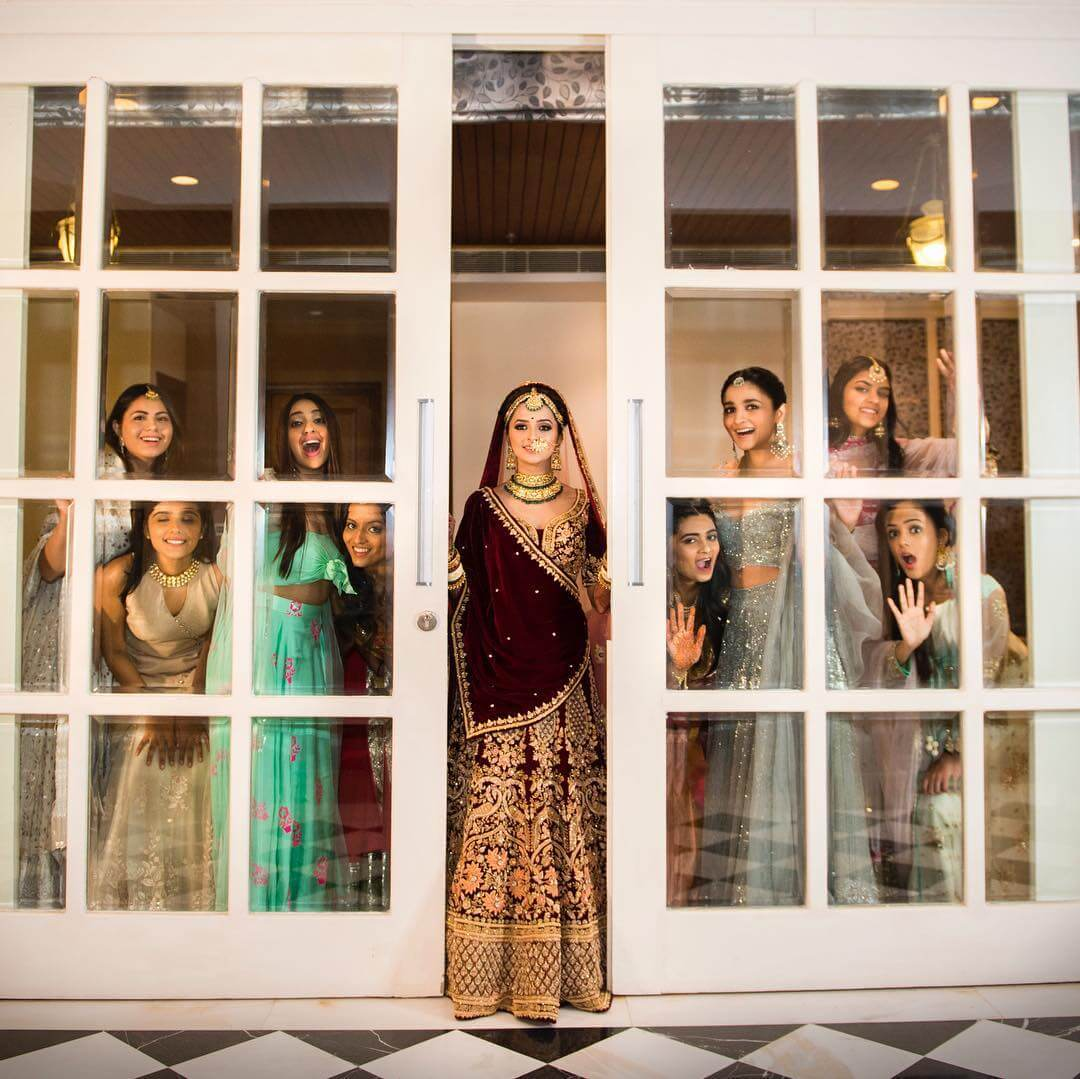 Image Of Bride With BFFs At The Glass Door