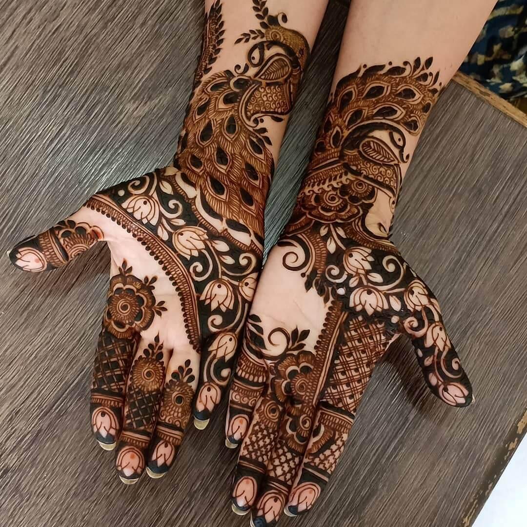. Dancing Peacocks Arabic Mehndi Full Hand Design