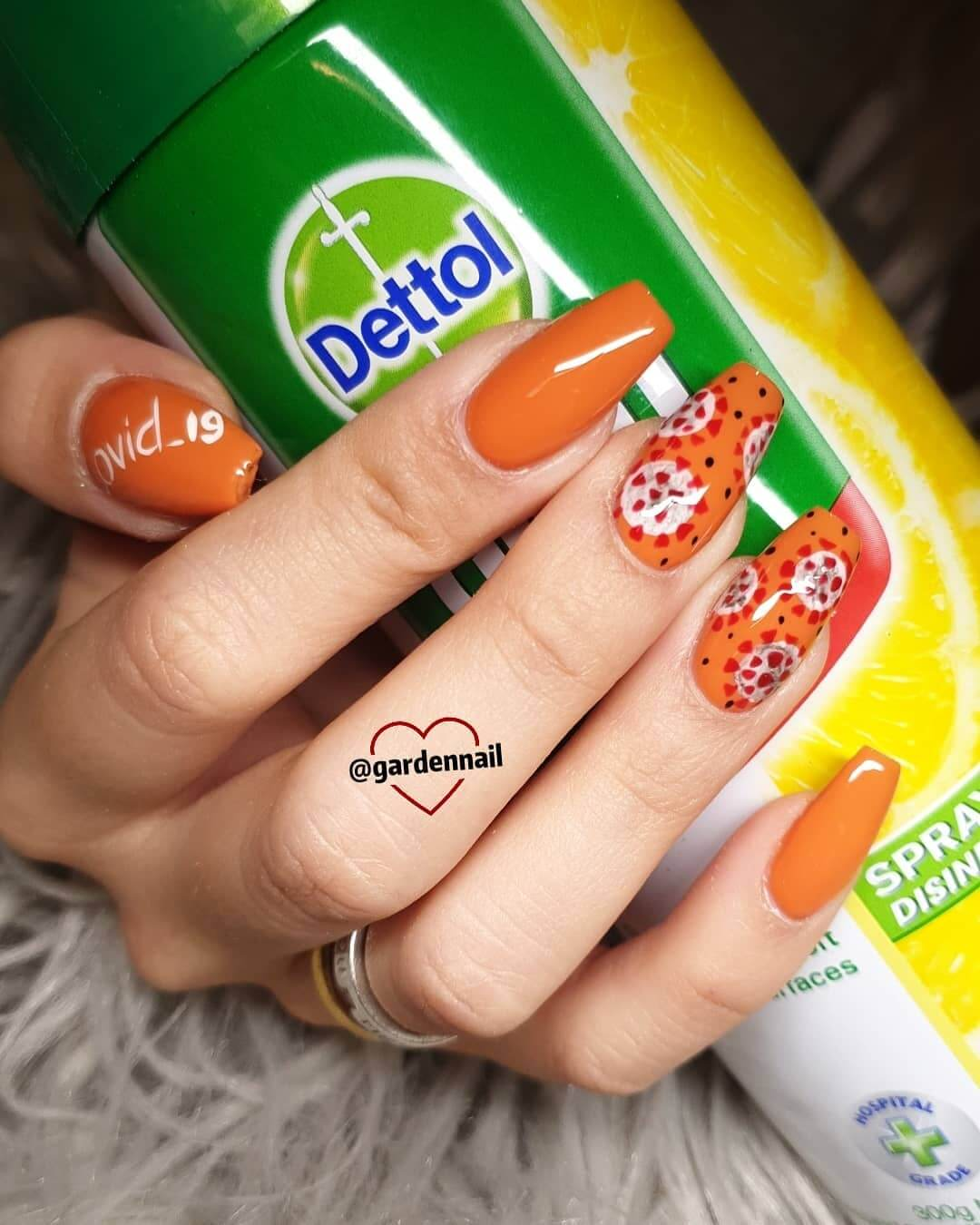 Subtle and Orange Coronavirus-themed nail art designs
