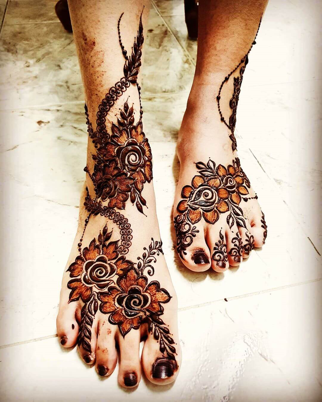 Swirling around with Roses Mehendi designs for Feet