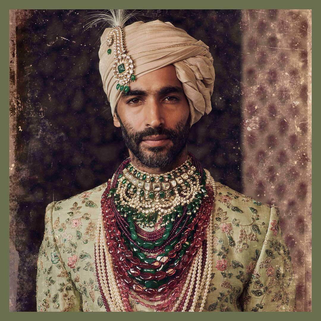 White and green pleated stone Kalgi Designs for Indian grooms