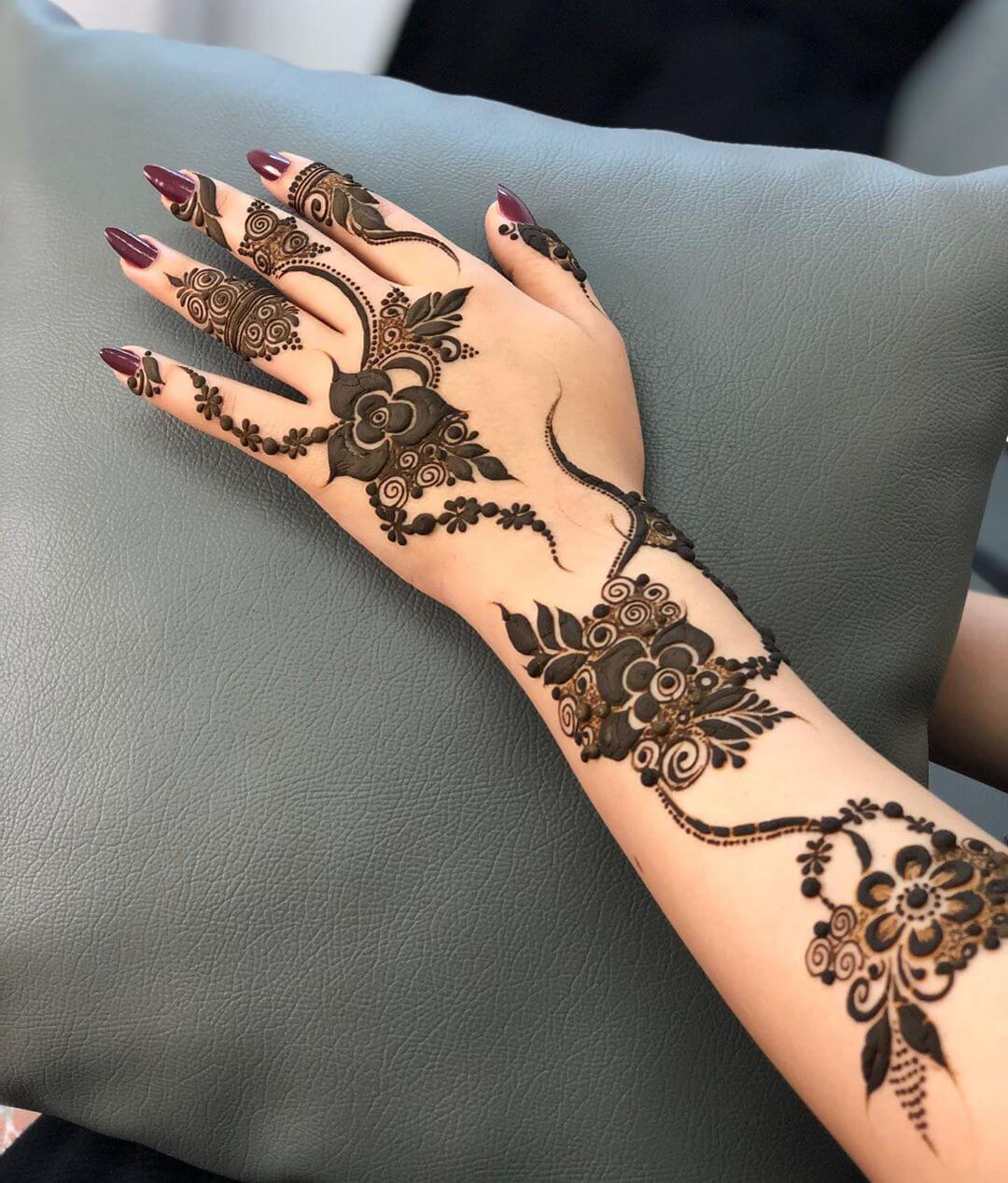 Petite Details mehndi designs for back hands