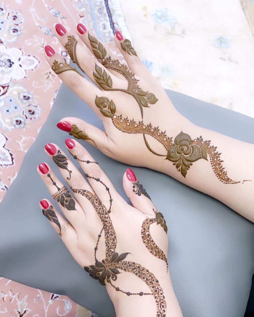 Thin Paisley strokes mehndi designs for back hands