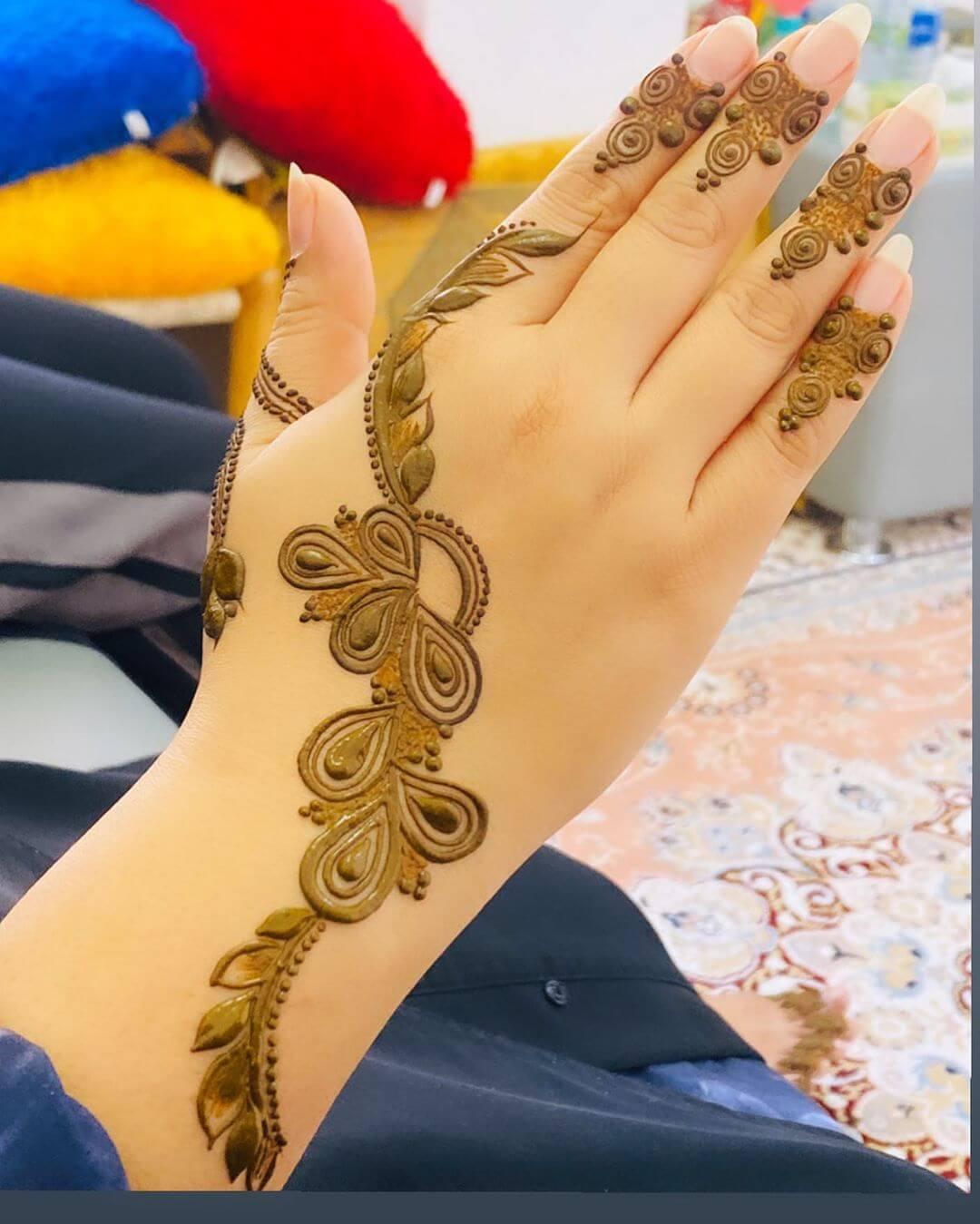Tear drop motifs mehndi designs for back hands
