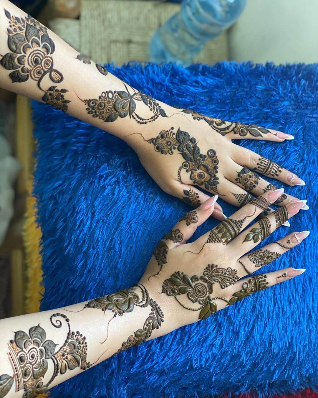 Symmetrical and Contemporary mehndi designs for back hands